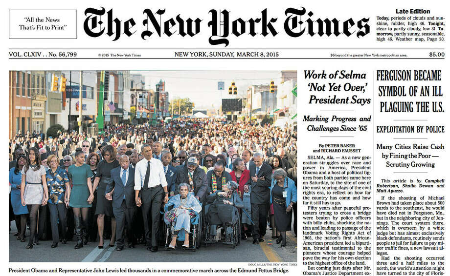 The frontpage of the New York Times on Sunday, March 8, 2015 depicts President Barack Obama leading a 50th anniversary march in Selma, Ala. Conspicuously missing from the front page photo is former President George W. Bush and wife Laura, who marched just a few feet to the left of Obama but was not included in the photo chosen for the front page. Photo: New York Times