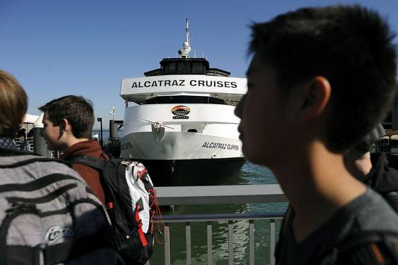 Crowds of passengers wait to board a ferry at the Alcatraz Ferry Landing in San Francisco, CA, on Friday, March 6, 2015.   A proposal has been put forth to move the Alcatraz Ferry, and the 1.3 million visitors it carries, from its current home at Pier 33 to Fort Mason.