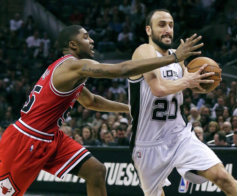 The Spurs' Manu Ginobili looks for room around the Chicago Bulls' E'Twaun Moore during second half action March 8, 2015, at the AT&T Center. The Spurs won 116-105. Photo: Edward A. Ornelas /San Antonio Express-News / © 2015 San Antonio Express-News