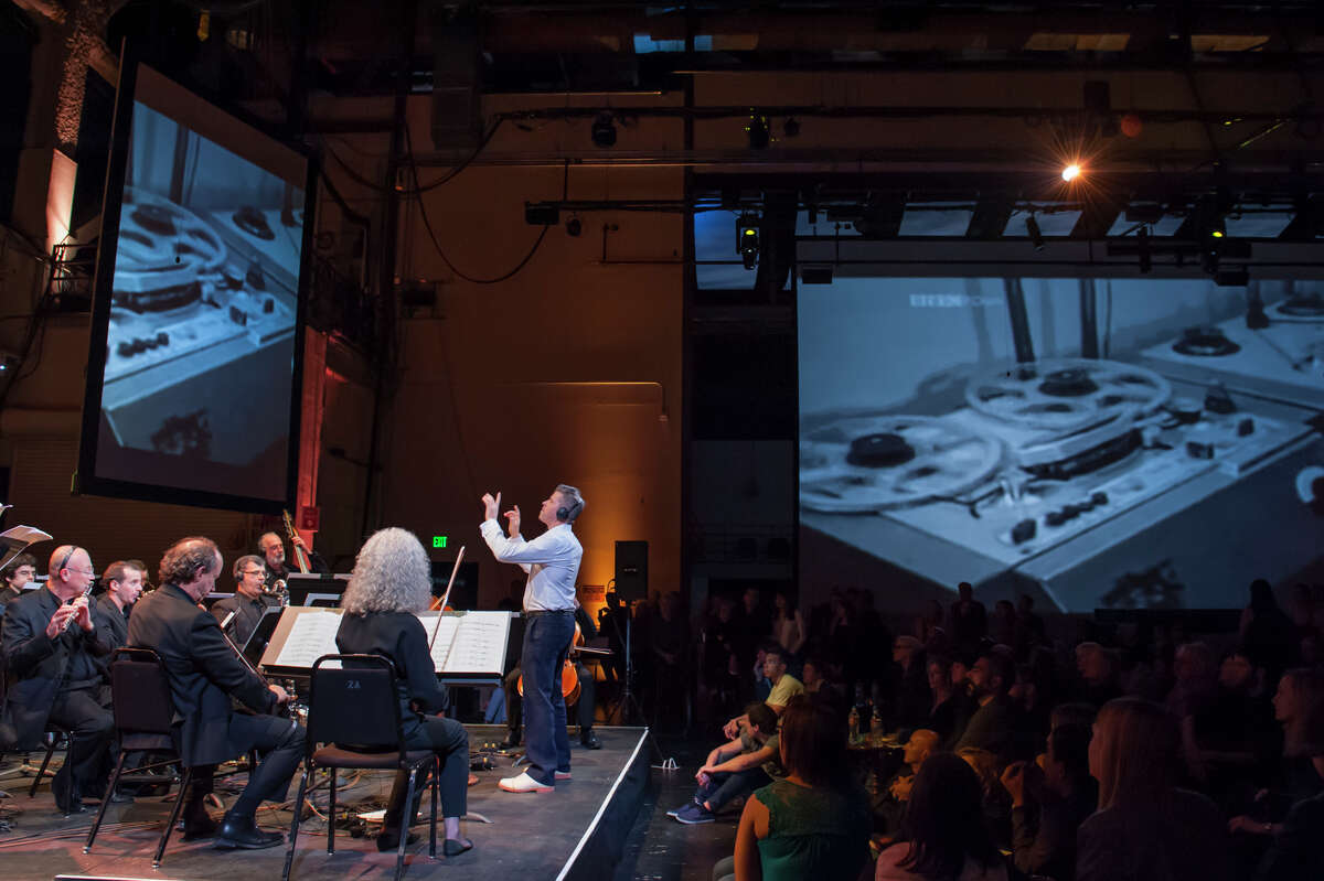 """Edwin Outwater conducts Nicole Lizée's """"Kool-Aid Acid Test #17: Blotterberry Bursst,"""" featuring visuals to help explore the culture that resulted from the creation and use of LSD, for the San Francisco Symphony's SoundBox series."""