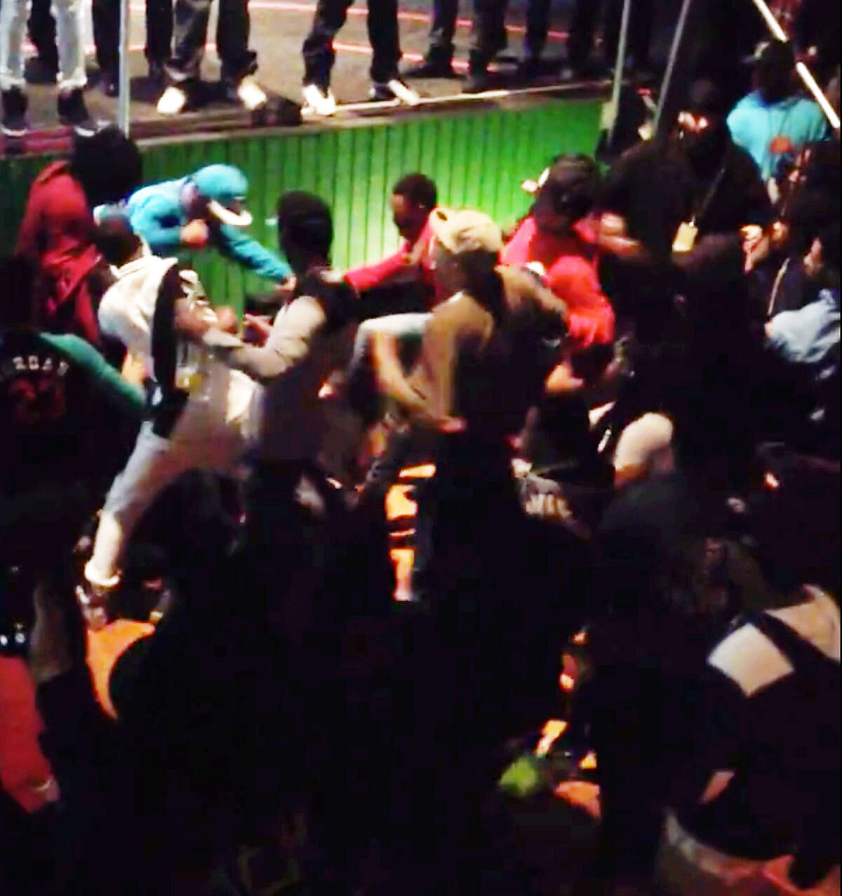 Screen grab from cellphone video shared on Youtube of the fight which broke out during the Saturday, March 7, 2015, Migos concert at the Washington Avenue Armory in Albany. (aj greggs/Youtube)