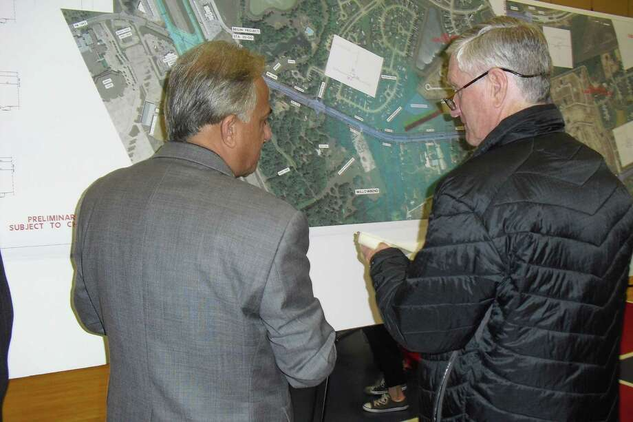 Gabriel Johnson, left, and Skip Conner review one of the maps displaying proposed widening of FM 1463 between Interstate 10 and FM 1093. They were among about 180 people who attended the Texas Department of Transportation's Feb. 26 project open house at Shafer Elementary School. Photo: Karen Zurawski