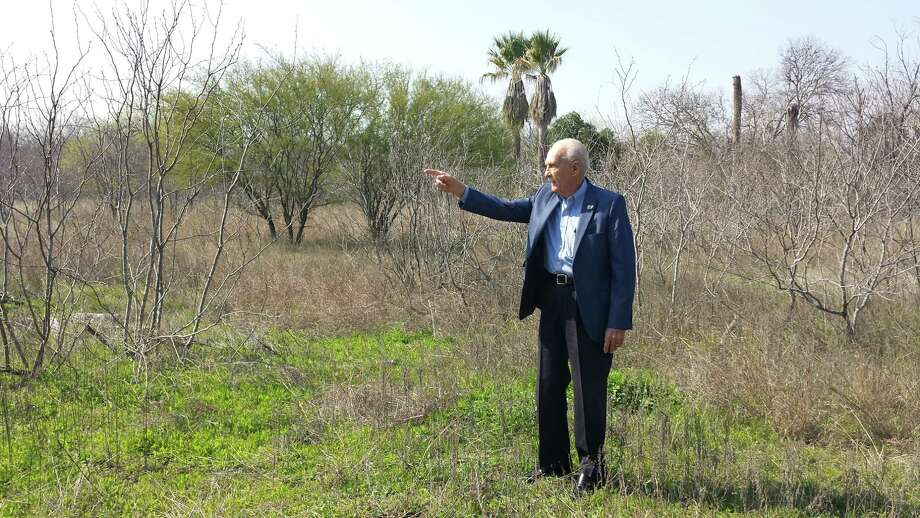 Converse historian Howie Marbach points to where the Converse School once stood on a 7.27-acre stretch of land that the Judson School District recently sold to the city of Converse. Photo: Jeff B. Flinn / Northeast Herald