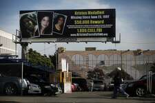 A billboard at 5th and Howard Streets, requesting information about  a missing woman named Kristen Modafferi, sits boldly above the street on Thursday Feb. 25, 2010 in San Francisco, Calif. Twelve years ago the 18-year-old college student disappeared and her parents have not given up the search. They recently placed 3 billboard and 5 bus signs around the city offering a reward for her whereabouts.