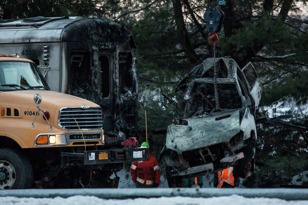 VALHALLA, NY - FEBRUARY 04: The sport utility vehicle that was hit by a Metro-North train is removed from the site of the accident on February 4, 2015 in Valhalla, New York. The crash started a fire in the train car that killed seven people, including the driver of the vehicle.