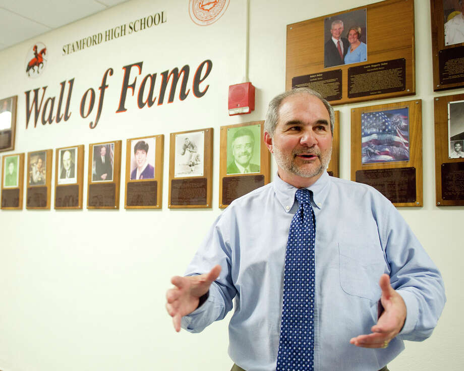 Stamford High School interim Principal Tony Pavia stands in the hallway on Wednesday, March 5, 2015, as he speaks about being chosen as Man of the Year by the State Street Debating Society. Photo: Lindsay Perry / Stamford Advocate