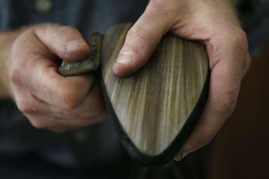 Principal and lead of design Frank Beneduci works on the sole of a boot in his studio in San Francisco, California on Tuesday, March 3, 2015.  He mixes stains and paints his leather soles to appear like wood. Photo: Liz Hafalia, The Chronicle