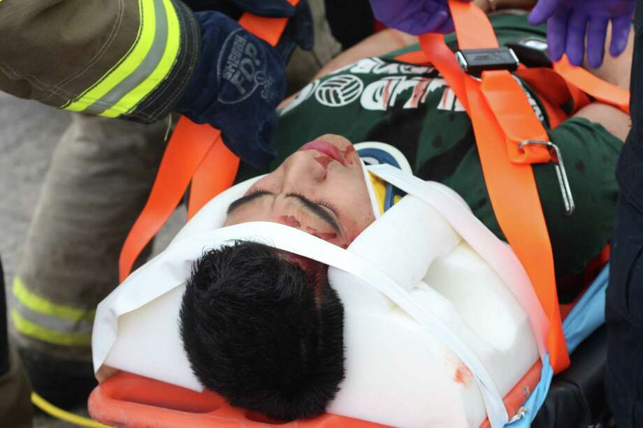 """Alex Arroyo portrays a severely injured passenger during the """"Shattered Dreams"""" mock disaster held March 3 at Marion High School. Photo: Photo Courtesy Of Marion High Sc"""