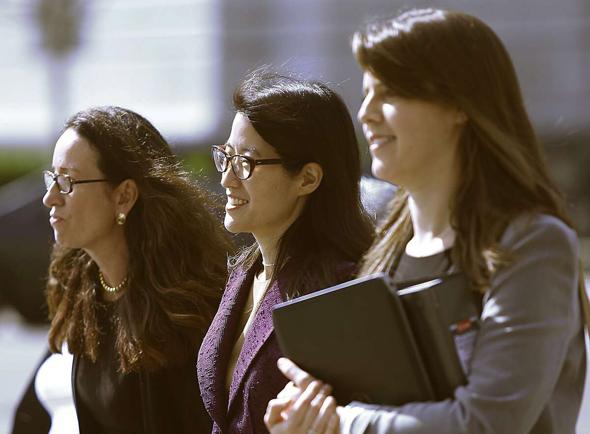 Ellen Pao (middle) takes a break with her attorneys after testifying in her suit against Kleiner Perkins in San Francisco, California on Monday, March 9, 2015.