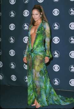 Jennifer Lopez caused a stir in her revealing green print Versace dress at the 42nd Grammy Awards in Los Angeles, Feb. 23, 2000. Photo: Sam Levi / WireImage / WireImage