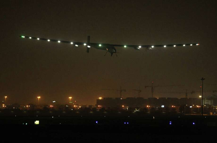 Solar Impulse 2 prepares to land in the Omani capital Muscat on Monday, completing the initial leg of its epic bid to become the first solar-powered plane to fly around the world. Photo: Mohammed Mahjoub /AFP / Getty Images / AFP