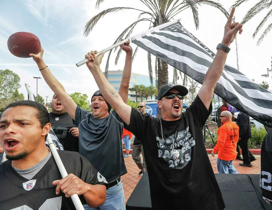 Oakland Raiders fans in the Los Angeles area celebrate the possibility that a football stadium will be football in Carson City, California, to house the Raiders and the San Diego Chargers. One of our readers says Los Angeles can take them. Photo: Damian Dovarganes /Associated Press / AP