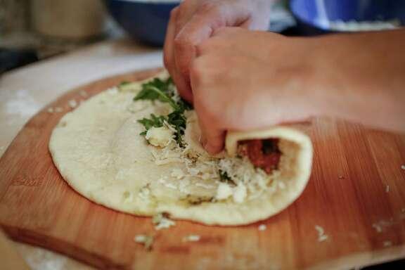 Reem Assil rolls man'oushe for an easy handheld snack.