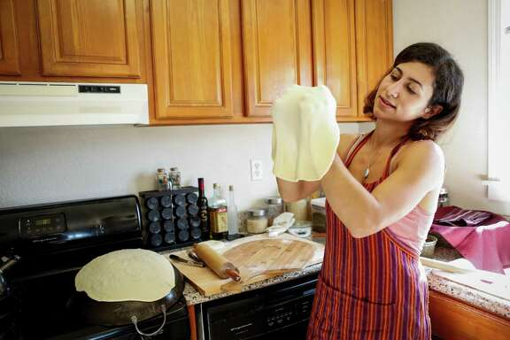 Reem Assil makes man'oushe in her Oakland home. It was during a 2010 visit to Syria and Beirut that she planned a new career.
