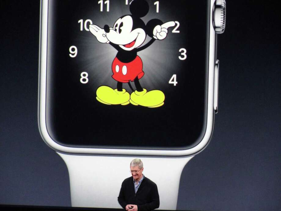Apple CEO Tim Cook unveils the Apple Watch in San Francisco. The watch is Apple's first new product since the iPad. Photo: Glenn Chapman /Getty Images / AFP