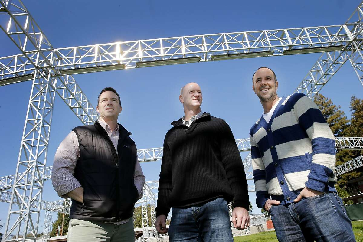 Atl the Napa Expo where their concerts will be held, Jason Scoggins (left), Justin Dragoo and Dave Graham looked over one of the stage areas Monday February 23, 2015. Three young entrepreneurs who grew up together in Napa, Calif. are the producers of the BottleRock music festival which will take place May 29-31 in downtown Napa.