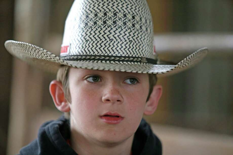 Jaron Sheehan, 13, of Magnolia prepares to ride a bull at the Kingstring Bucking Bulls ranch Monday, March 2, 2015, in Pine Valley. Photo: Melissa Phillip, Houston Chronicle / © 2014  Houston Chronicle