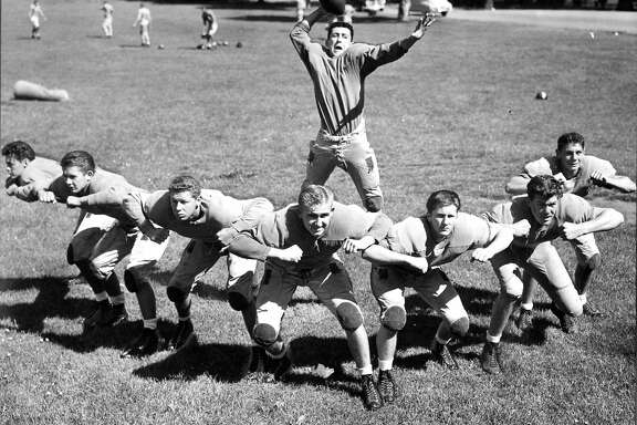 Sept. 16, 1948: Members of the Polytechnic High School football team, including future NFL star Bob St. Clair (second from right), pose for a photo in Golden Gate Park.