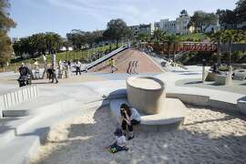 Sebastian Berle-Smith, 2 years old, plays at the sandbox with new sand in the children's playground at Dolores Park in San Francisco, California on Monday, March 9, 2015.  Twenty tons of sand replaced polluted sand by vandals breaking bottles a few weeks ago.