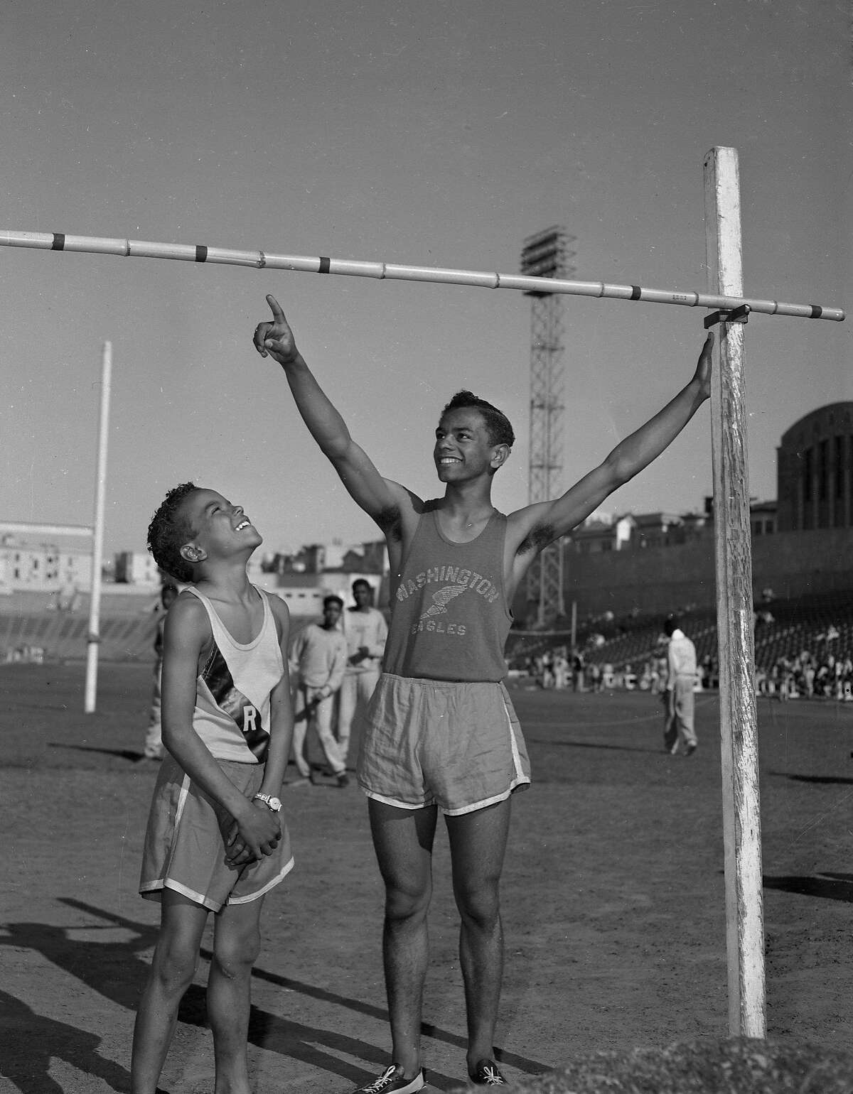 Johnny Mathis and his brother Ralph Mathis inspecting the bar for a try at the high jump at Kezar stadium 04/18/1953 From the negative .. photographer not identified