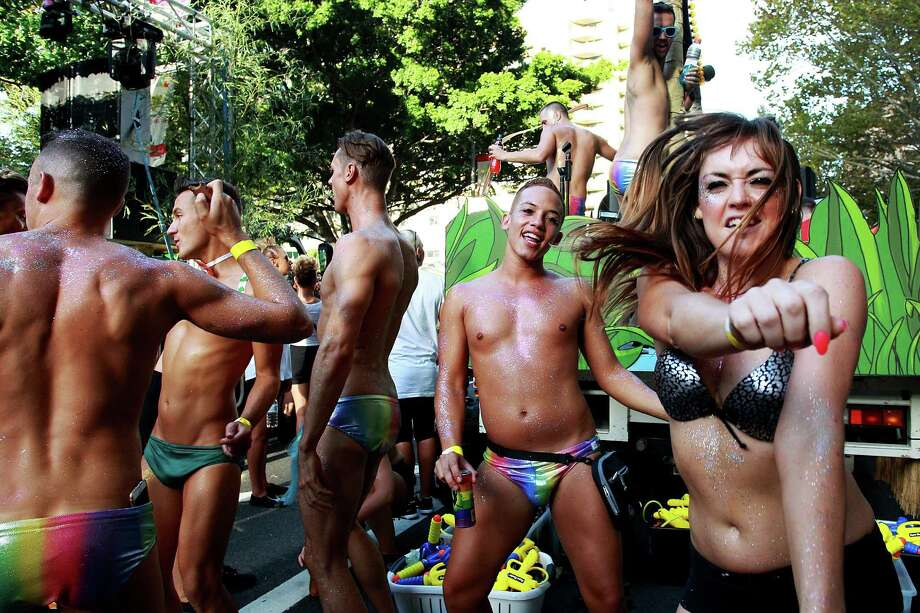 Parade goers prepare ahead of the start of the 2015 Sydney Gay & Lesbian Mardi Gras Parade on March 7, 2015 in Sydney, Australia.  The Sydney Mardi Gras parade began in 1978 as a march and commemoration of the 1969 Stonewall Riots of New York. It is an annual event promoting awareness of gay, lesbian, bisexual and transgender issues and themes. Photo: Lisa Maree Williams, Getty Images / 2015 Getty Images