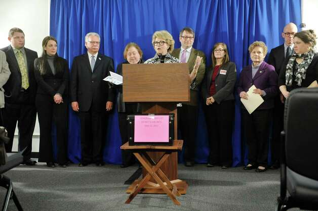 Barbara Bartoletti, League of Women Voters legislative director, surrounded by legislators, and representatives from civic groups, labor organizations and public education advocates, voices her opposition to the education investment tax credit in Governor CuomoOs budget, during a press conference on Monday, March 9, 2015, in Albany, N.Y.  (Paul Buckowski / Times Union) Photo: PAUL BUCKOWSKI / 00030939A