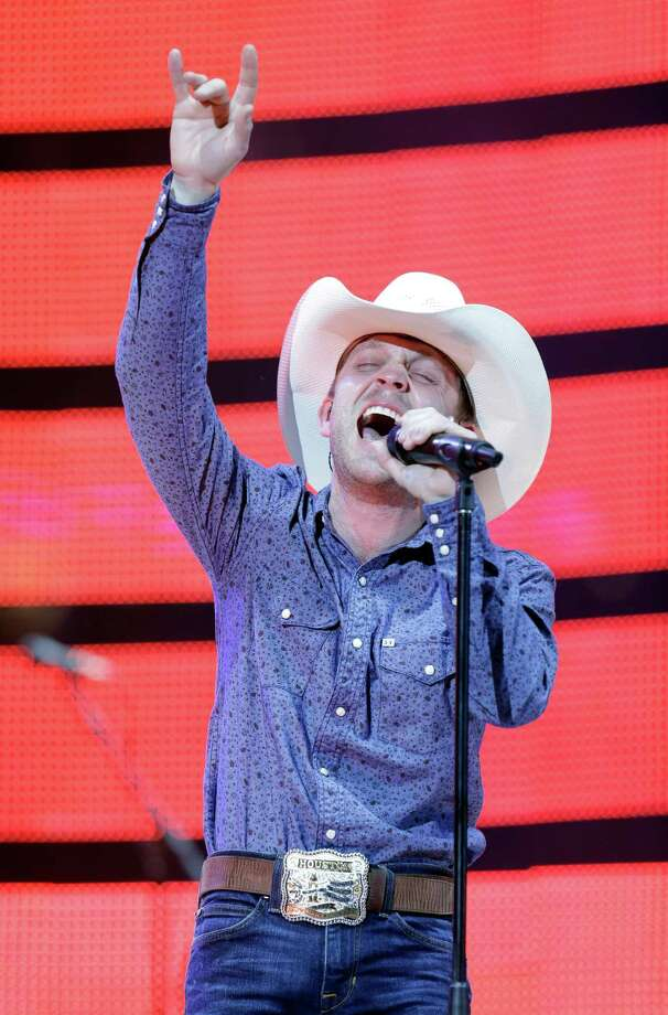 Justin Moore performs at RodeoHouston on Monday. Photo: Melissa Phillip, Houston Chronicle / © 2014  Houston Chronicle