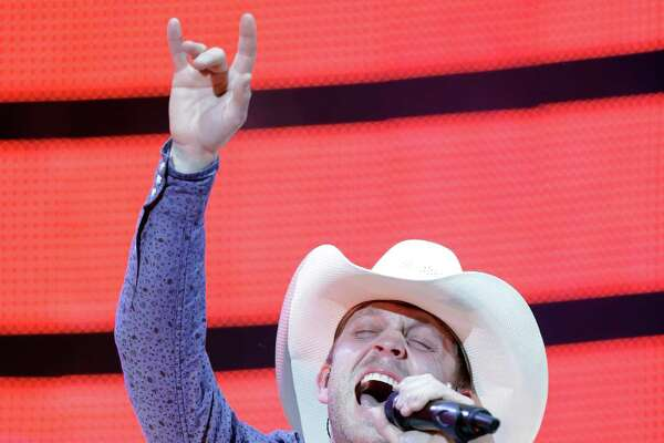 Justin Moore performs during RodeoHouston at the Houston Livestock Show and Rodeo in NRG Stadium Monday, March 9, 2015, in Houston.