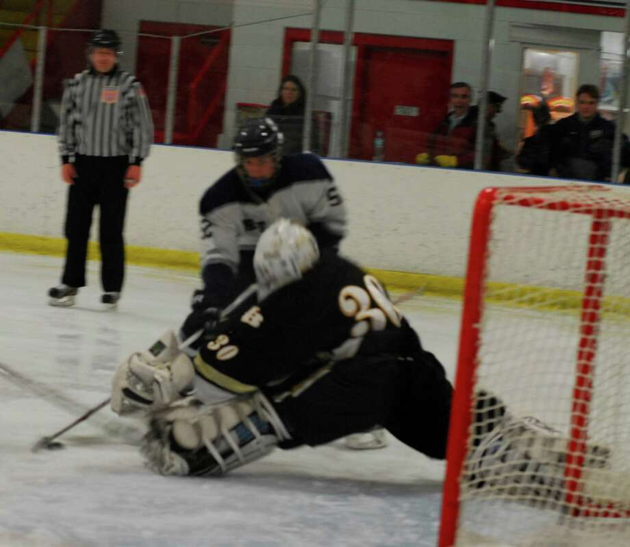 Staples-Weston-Shelton sophomore Zaritsky goes for a shot against Barlow goalie Connor Jones during the teams' Division III first round game on Monday. Staples won 4-3. Photo: Ryan Lacey/Staff / Westport News Contributed