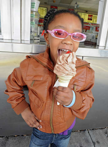 Sandra Parson, 4, eats an ice cream cone on opening day of the season of Kurver Kreme March 15, 2012 in Colonie, N.Y. Sandra and her mom came from Rotterdam to eat this seasonal treat. Kurver Kreme celebrates it's 60th year in business. (Lori Van Buren / Times Union) Photo: Lori Van Buren / 00016853A