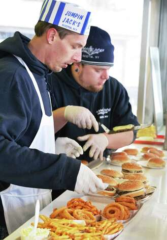 Short order cooks Jackson Eiarman, left, and James Gauthier work to keep up with a long line of customers as Jumpin' Jack's Drive-In opens for another season Thursday March 27, 2014, in Scotia, NY.  (John Carl D'Annibale / Times Union) Photo: John Carl D'Annibale / 00026298A