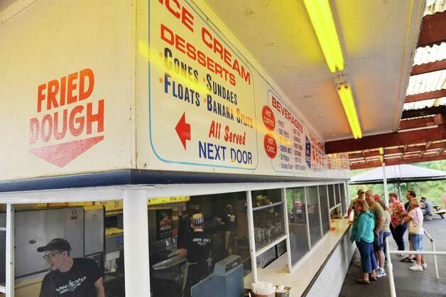 Customers line up to order food during the final day of the season at Jumpin Jack's Drive-In on Sunday, Aug. 31, 2014, in Scotia, N.Y.    (Paul Buckowski / Times Union) Photo: Paul Buckowski / 10028401A