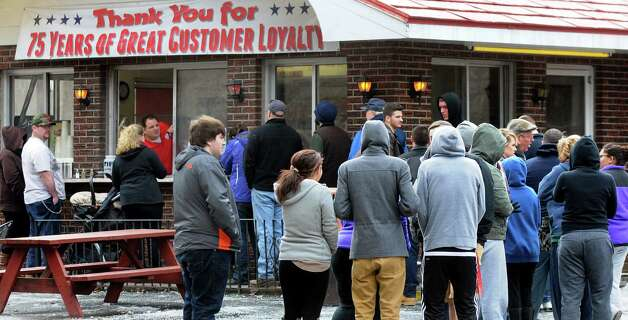 Opening day customers line up to order lunch on Wednesday, March 19, 2014, at Jack's Drive In in Wynantskill, N.Y. The drive-in's opening signals the start of spring. (Cindy Schultz / Times Union) Photo: Cindy Schultz / 00026205A