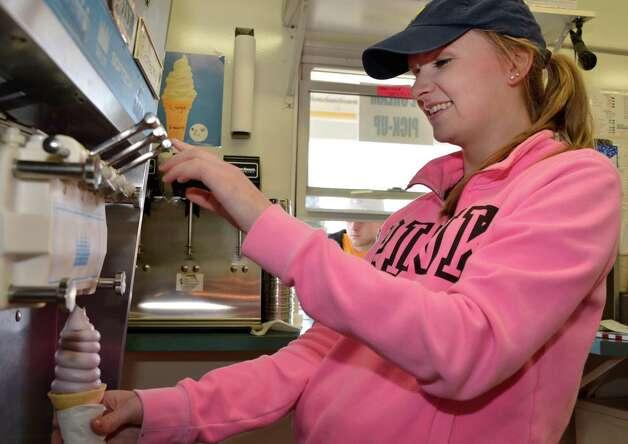 Becky Schweda prepares a soft ice cream cone as Devoe's Rainbow Delights in Halfmoon reopens for season Wednesday April 3, 2013.   (John Carl D'Annibale / Times Union) Photo: John Carl D'Annibale / 00021835A