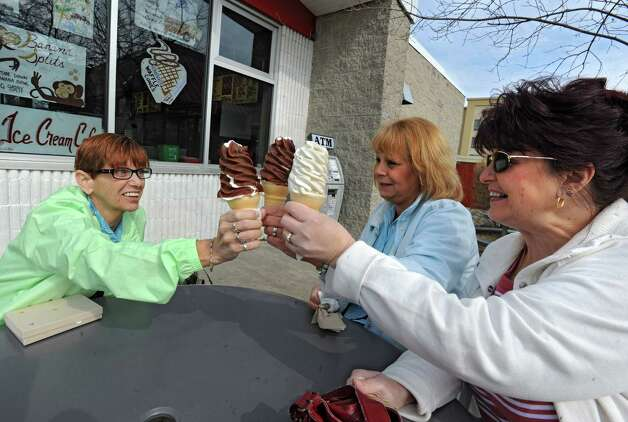"From left, friends Hazel Yeman, Sue Snyder and MaryAnn Rajczewski, all of Colonie, toast with their ice cream cones on opening day of the season of Kurver Kreme March 15, 2012 in Colonie, N.Y. The said ""This is a holiday for us."" Kurver Kreme celebrates it's 60th year in business. (Lori Van Buren / Times Union) Photo: Lori Van Buren / 00016853A"