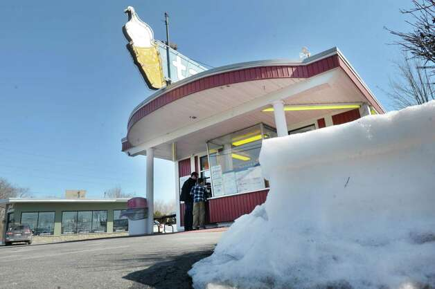 Snow banks remain in the parking lot as customers get ice cream at Jim's Tastee Freez on Monday, March 9, 2015, in Delmar, N.Y. The ice cream stand opened March 7 to start their season.   (Paul Buckowski / Times Union) Photo: PAUL BUCKOWSKI / 00030946A