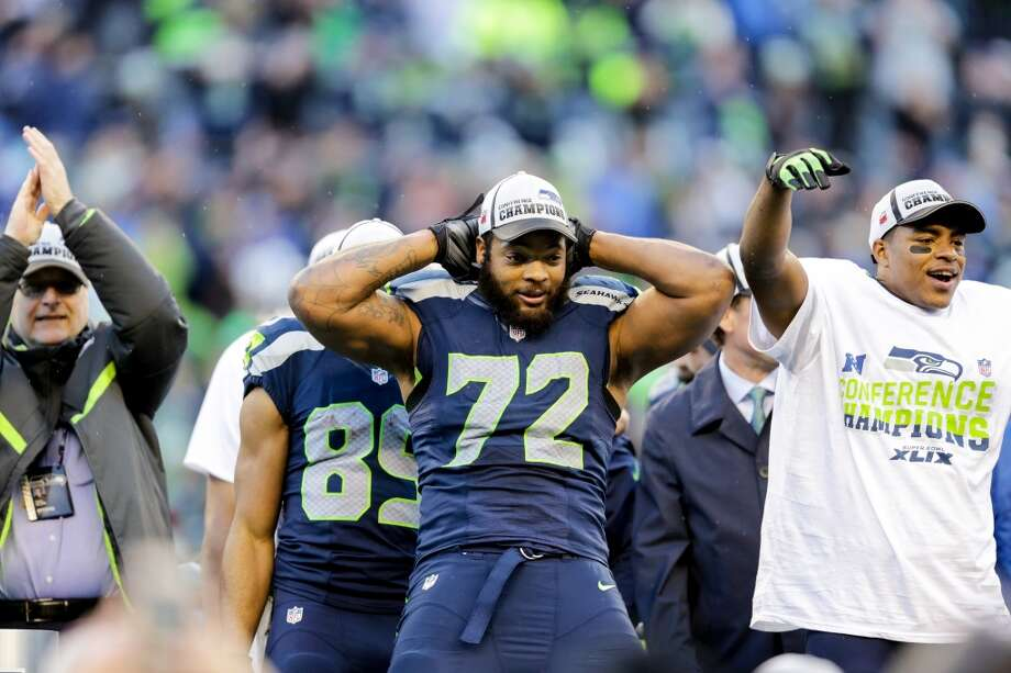"""BEST DE Michael Bennett Previous team: Tampa Bay Contract: One year, $5 million Before the 2013 season, the Seahawks took a shot at a promising yet largely unheralded pass-rusher out of Tampa. Signed for just one year, Bennett blossomed in Seattle and quickly became a key defensive piece of the Hawks' first championship team. Last offseason, GM John Schneider locked up Bennett with a four year, $28.5 million contract, and """"Moses Bread"""" -- as he calls himself on Twitter -- is now a star on the NFL's best defense. Photo: Scott Eklund, Seattlepi.com"""