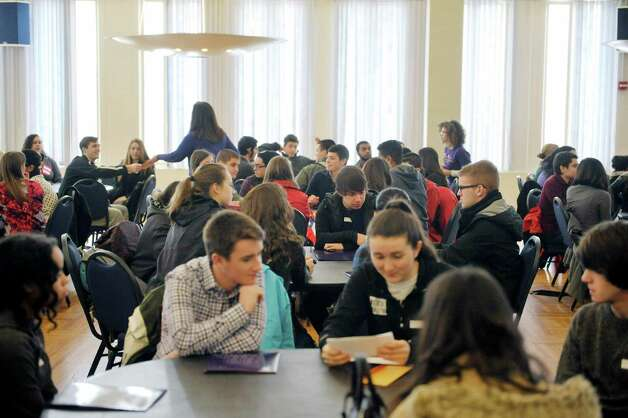 Area high school students go over their initial instructions as they take part in a scavenger hunt during Spanish Heritage Day at the University at Albany on Monday, March 9, 2015, in Albany, N.Y. The event which is hosted by the Department of Languages, Literatures & Cultures, gives high school students total immersion in a language for the day. (Paul Buckowski / Times Union) Photo: PAUL BUCKOWSKI / 00030913A