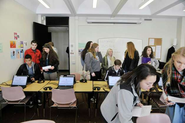 Area high school students use laptops to complete a step  as they take part in a scavenger hunt during Spanish Heritage Day at the University at Albany on Monday, March 9, 2015, in Albany, N.Y. The event which is hosted by the Department of Languages, Literatures & Cultures, gives high school students total immersion in a language for the day. (Paul Buckowski / Times Union) Photo: PAUL BUCKOWSKI / 00030913A