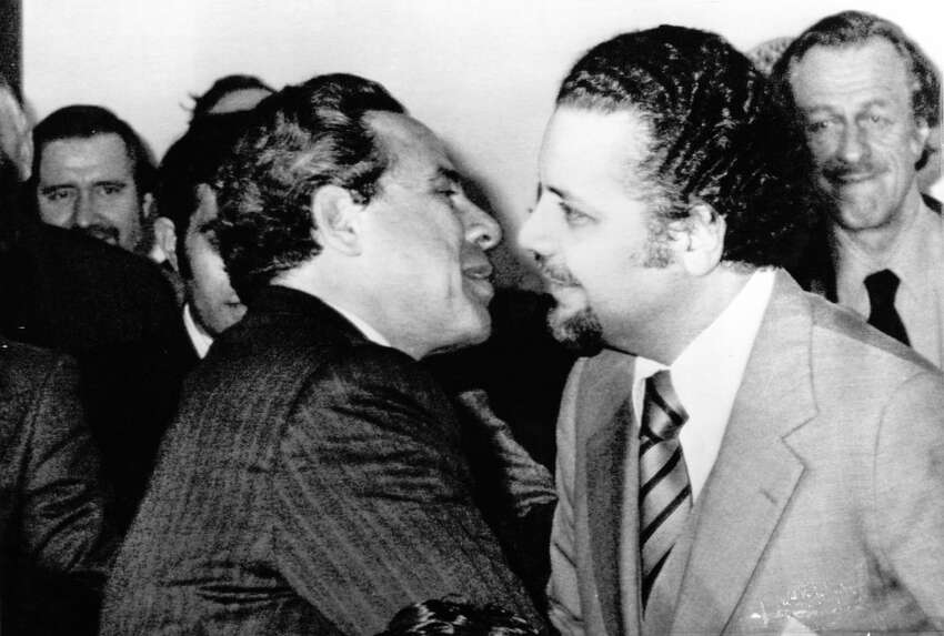Vienna, AUSTRIA, Mar. 17, 1974 - OPEC SESSION -- Egyptian oil minister Ahmed Hillal (L) and Saudi Arabian oil minister Zaki Yamani embrace at the start of a session of the Organization of Petroleum Exporting Countries (OPEC) meeting in Vienna Sunday night, March 17, 1974. (AP Wirephoto)