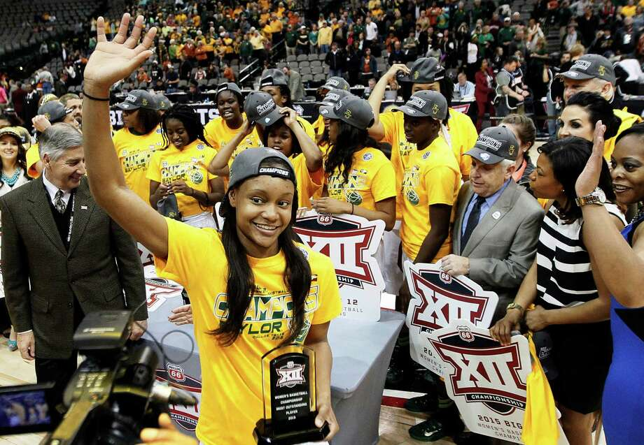 """Baylor forward Nina Davis waves to fans after accepting the """"Most Outstanding Player"""" award after the Lady Bears 75-64 win over Texas in the Big 12 Conference tournament championship Monday. Photo: Brandon Wade /Associated Press / FR168019 AP"""