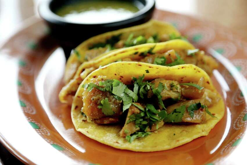 Chicharron Tacos are pork rinds cooked with house tomatillo salsa at Luna y Sol.