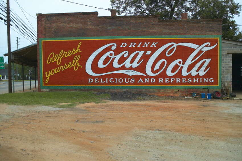 Coca-Cola: Corporate Sponsor Headquarters: Atlanta, Ga. Nearby tournament teams: Georgia State, University of Georgia Market cap: $175.7 billion 2014 revenue: $45.9 billion CEO name and alma mater: Muhtar Kent - University of Hull and City University London Global soda pop titan Coca-Cola Co. is based in Atlanta. Georgia State University and University of Georgia are contentders this year. CEO Muhtar Kent was educated in the United Kingdom.