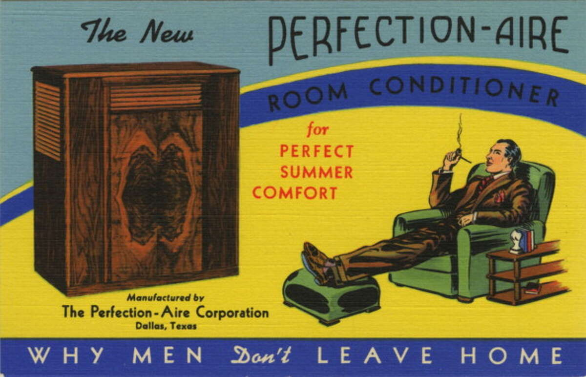 Vintage postcard view of a room air conditioner with a man in chair, wearing a suit, smoking a pipe, with his feet on an ottoman.