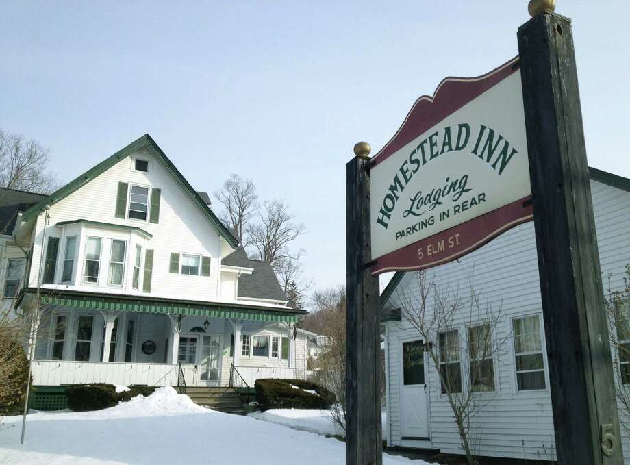 The Homestead Inn along Elm Street in the New Milford village center will close its doors Sunday, March 15, 2015 after 87 years in business. Photo: Norm Cummings / The News-Times