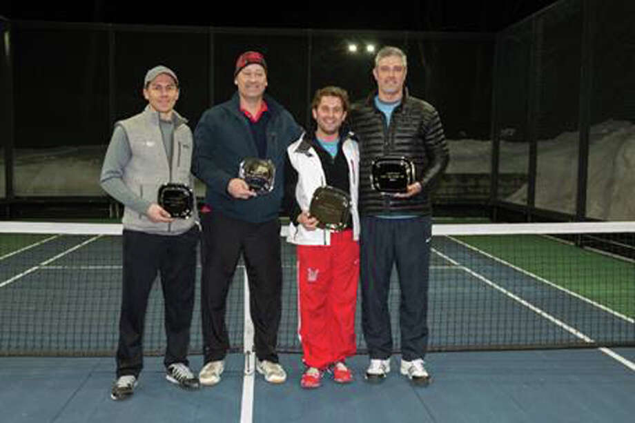 Runners-up Brian OíHara and R.P. Beuerlein pose with winners Rob Blosio, Jr., of New Canaan, and Colin White, of Darien, at Battle with a Paddle, a fundraiser for AmeriCares on March 7. Photo: Lisa Garcia/Contributed Photo, Contributed Photo / Darien News