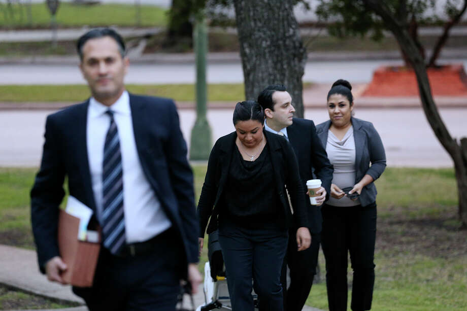 Strippers Alexis Alex, center, and Nicolette Prieto, right, arrive at the U.S. Federal Courthouse for their lawsuit trial against former employer, Tiffany's gentlemen's club, Tuesday, March 10, 2015. The two are claiming that the club violated the fed era Fair Labor Standards Act by shorting them on minimum wage and overtime pay. With them are their attorneys, Robert Debes, left, and Ricardo Prieto. Photo: JERRY LARA, San Antonio Express-News / © 2015 San Antonio Express-News