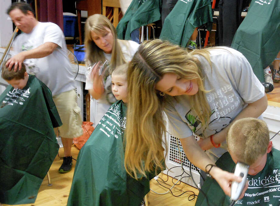 Youngsters get their heads buzzed during Team Teddy's 2012 St. Baldrick's event. This year's fundraiser is Friday, March 20, and proceeds benefit pediatric-cancer research. Photo: Mike Lauterborn, File Photo / Fairfield Citizen contributed