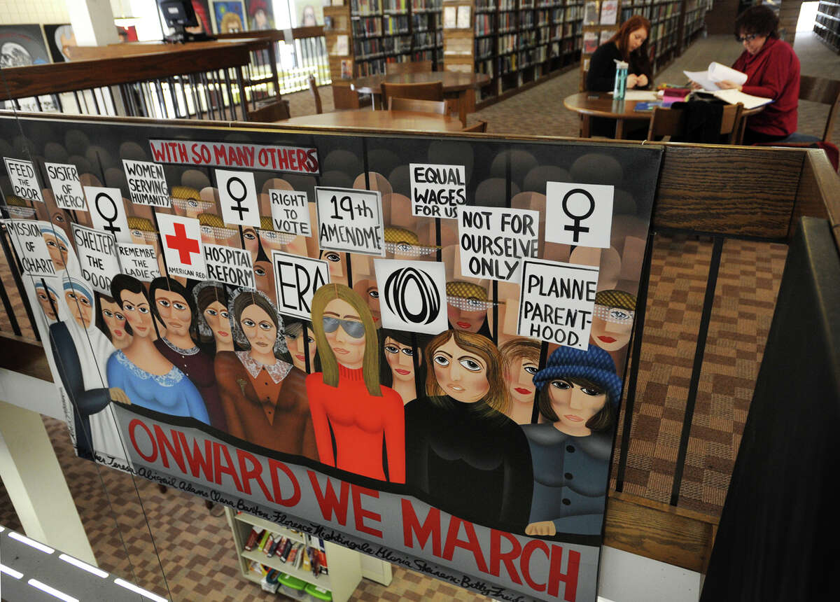 """""""Onward We March"""", one of a large series of abstract portrait paintings by artist Robin Morris, is back on display at the Trumbull Public Library in Trumbull, Conn. on Tuesday, March 10, 2015. Complaints have arisen because the painting features both Mother Teresa and Planned Parenthood founder Margaret Sanger."""