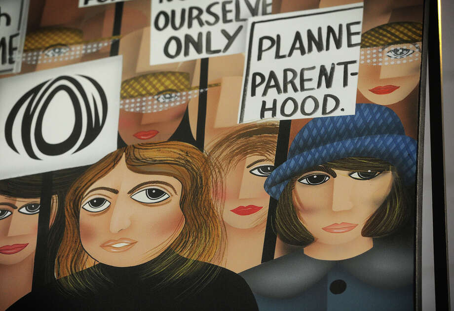 """Planned Parenthood founder Margaret Sanger, right, is pictured in the painting """"Onward We March"""", one of a large series of abstract portraits by artist Robin Morris, on display at the Trumbull Public Library in Trumbull, Conn. on Tuesday, March 10, 2015. Photo: Brian A. Pounds / Connecticut Post"""